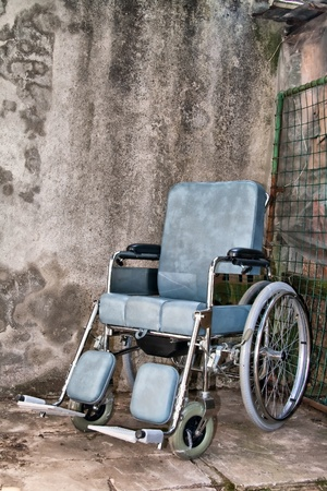 squalid: a brand new wheelchair over a squalid background