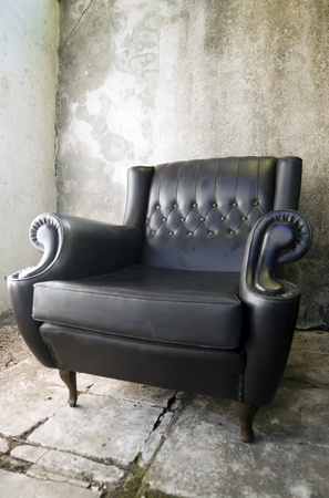 leather armchair: retro style black leather armchair Stock Photo