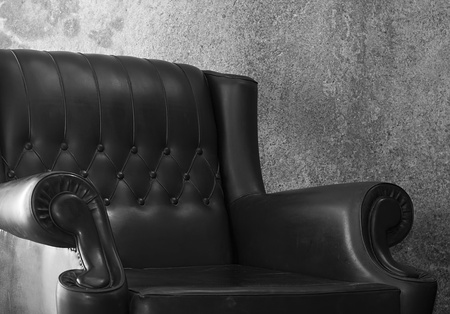 details: close up of a classic retro armchair ,black and white shot