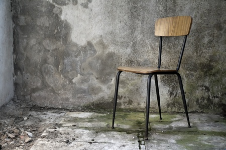 grunge shabby interior with a simple single chair photo