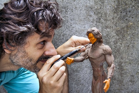 plasticine: close up of a sculptor at work on a miniature