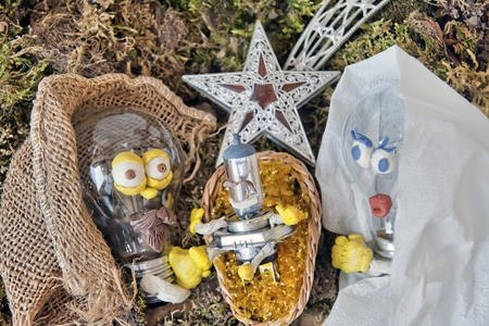 nativity scene with bulbs, figures made out of plasticine