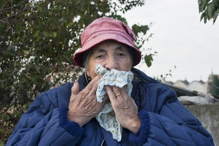 senior woman with allergy or cold , outdoor shot