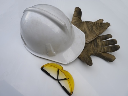 hard hat with safety glasses and leather gloves  photo