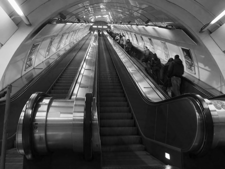 passenger on escaletor in a subway station  photo