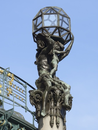 Art Nouveau statues at the top of a building in Prague photo
