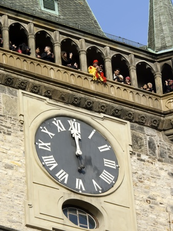 PRAGUE,CZECH REPUBLIC-NOVEMBER 6: Trumpeter in costume plays at midday from the Astronomical Clock Tower on November 6, 2011 in Prague, Czech Republic. Stock Photo - 11249605