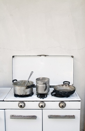 vintage cooker with old pots and pan photo