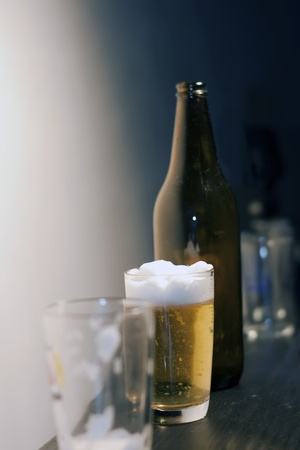 ber: close up of  some glasses and a bottle of beer