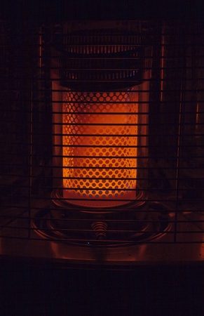 liquid petroleum  heater, close up in a dark room Stock Photo - 11799001