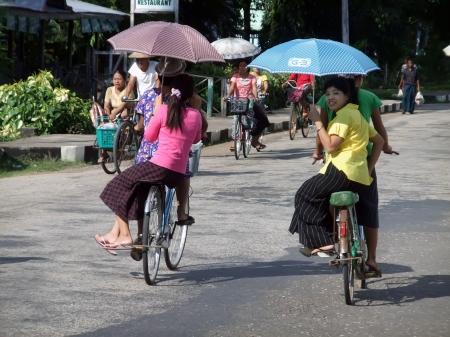 burmese: NYAUNG-U, MYANMAR- NOVEMBER 2: Bicycles traffic on a hot day in Nyaung-U, Myanmar on November 2, 2010 Editorial