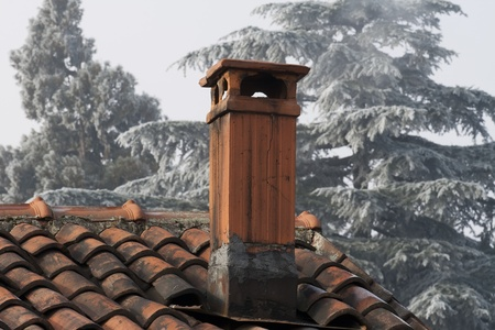 Chimney on the roof of an old stone built house