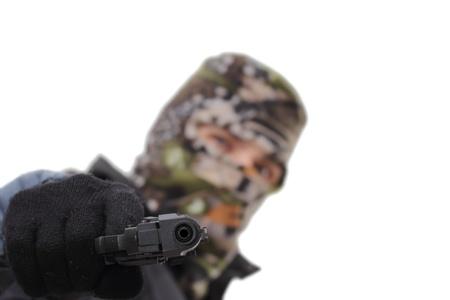 merciless: masked man aiming a handgun