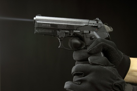 Shooting Handgun against black background photo