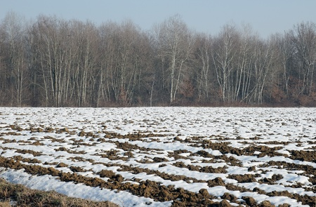 plowed soil of an agricultural field in winter time Stock Photo