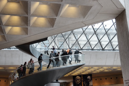 PARIS - MARCH 17: visitor entrance to the Louvre Museum on March 17, 2012 in Paris. Louvre is the biggest Museum in Europe