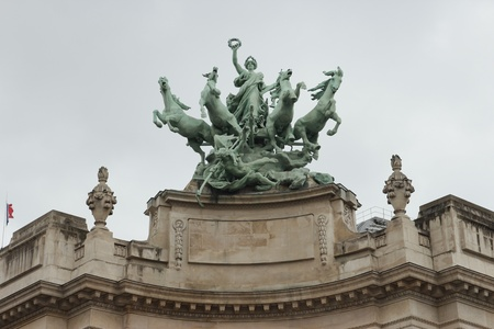quadriga: monumental bronze quadriga by Georges tops Grand Palais building, Paris, France Editorial
