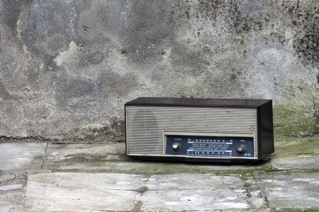 Old retro Radio in a shabby interior Stock Photo - 13275672