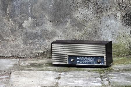 Old retro Radio in a shabby interior Stock Photo - 13275672