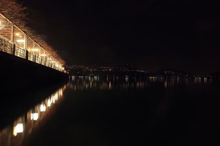arona: Night view of the promenade beside the Maggiore Lake in Arona, Italy Stock Photo