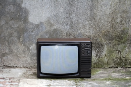 Old retro Television in a shabby interior photo