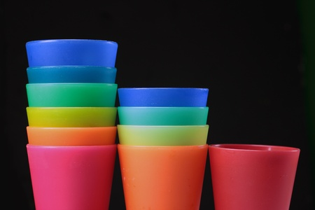 colorful plastic glasses over a dark background Stock Photo - 13297818