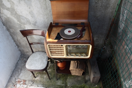 Vintage Radio Receiver cabinet  in a shabby  home interior photo