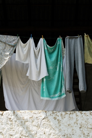 Laundry hanging on lines in rural building photo