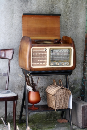 Vintage Radio Turntable cabinet  in a shabby  home interior photo