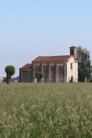 xv century: ancient solitary XV century church in Suno, Italy Stock Photo