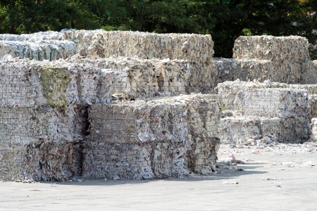 pile reuse: paper bales ready for recycling at paper factory plant