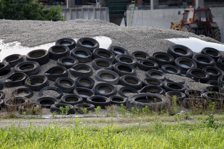 Pile of Old Used Car TIres in a farm photo