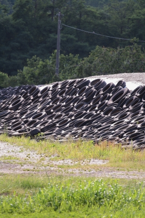 pile of used Car Tires in rural place photo