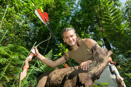 recurve: archer with 3d target posing in the forest