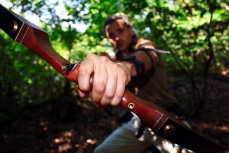 robin hood: archer aiming his bow against the camera Stock Photo