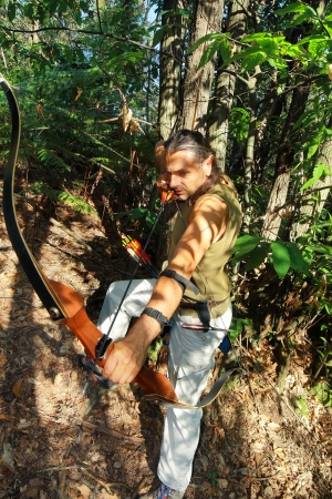 pointed arrows: archer with elven ears in the forest Stock Photo