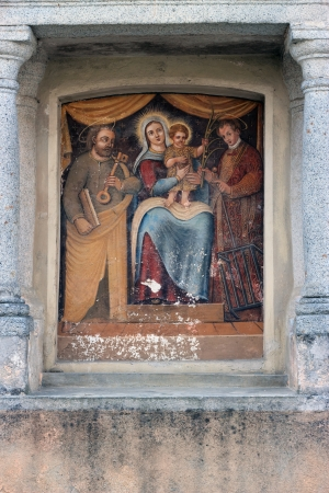 laurence: house exterior Religious Devotional painting in Alzate di Momo, Italy Editorial