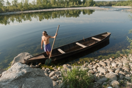boat oarsman on Ticino River, Piedmont, Italy photo