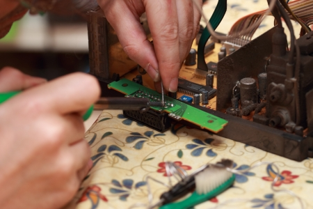close up of a  Man repairing a scart photo