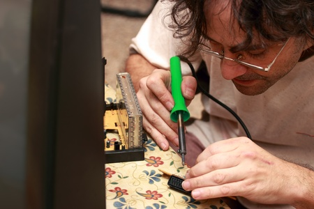 close up of a  Man repairing an old Tv Stock Photo