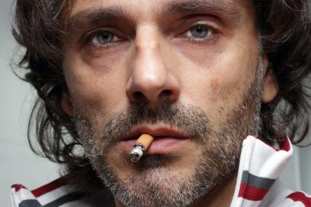 Man with a cigarette close-up portrait  Stock Photo