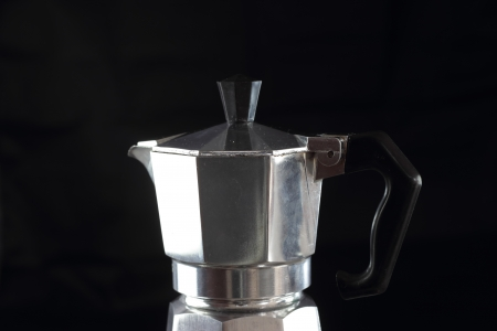 with coffee maker: retro coffee maker close up over black background