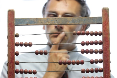 actuary: pensive accountant with an old abacus Stock Photo