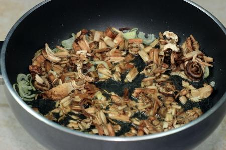 cooking mushrooms in frying pan Stock Photo - 15810576