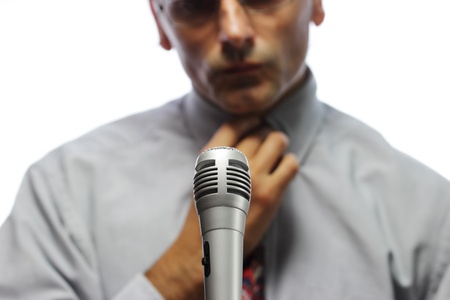 public speaker: microphone  and out of focus Public speaker