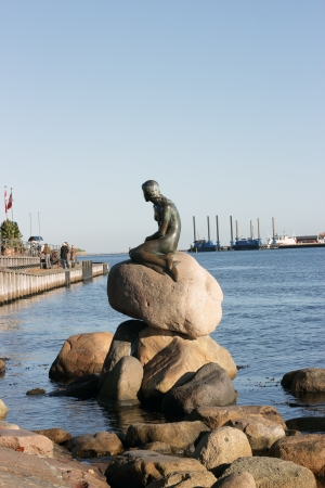 COPENHAGEN, DENMARK - OCTOBER 2012   Little Mermaid statue in Nyhavn  on October 28 2012 Copenhagen, Denmark Editorial