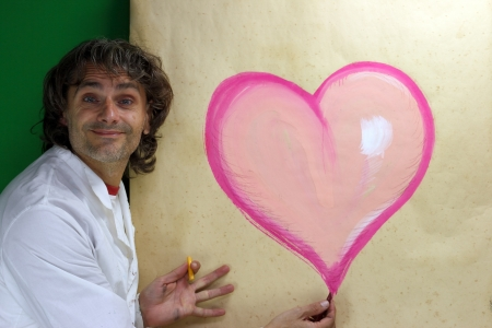 Artist drawing Heart with pastel Stock Photo