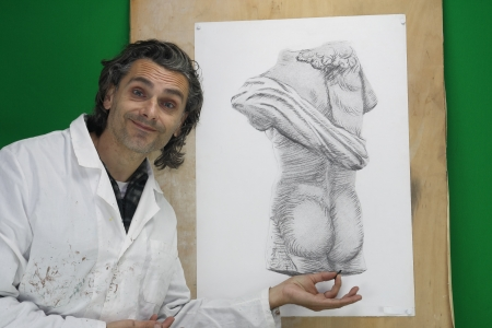 artist doing a charcoal drawing of a greek statue copy