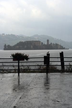 lake Orta under heavy rain, isle of San Giulio in the background