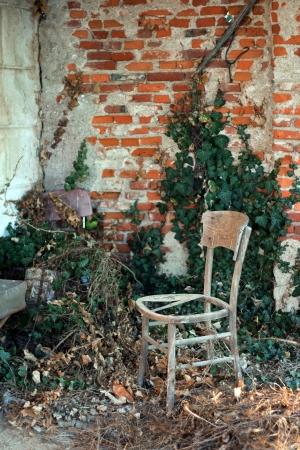 broken chair: wooden broken abandoned chair in a ruin